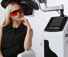 Woman receiving laser hair treatment