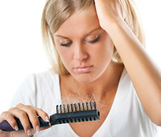 Woman worried about hair falling out