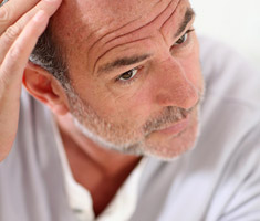 Middle aged man hoping to find a baldness cure