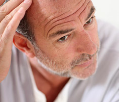 male considering the alternatives to hair transplant