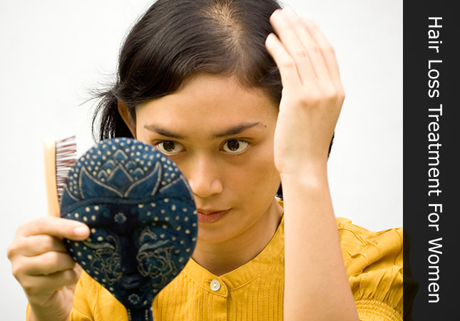 Person suffering from female pattern baldness