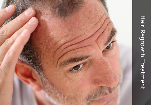 Older gentleman discussing hair regrowth for men