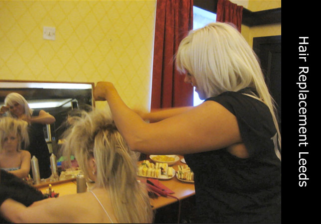 Invisi Hair clinic Leeds, UK, Female mobile hairdresser cutting a clients hair