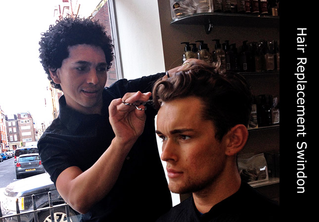 talented male hair replacement stylist inside his hairdressing salon in Swindon, UK