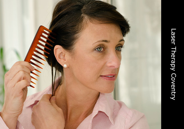 Atractive woman displaying beautiful hair and promoting hair growth laser treatment in Coventry