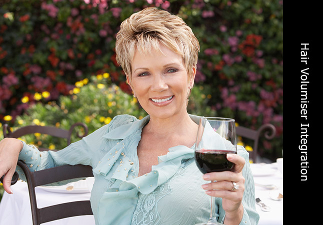 Attractive middle aged woman wearing an Invisi Hair volumiser short hair style