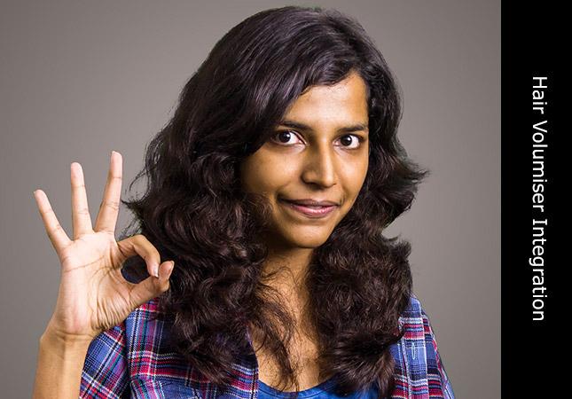 Beautiful Asian woman demonstrating Indian Remy hair volumiser