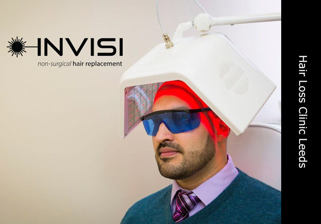 Male client sitting under the Invisi hair growth laser machine in Leeds Yorkshire