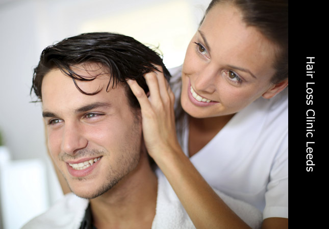 Woman performing hair replacement on a male client at Invisi Hair Leeds Yorkshire